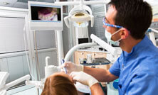 dentist using intraoral camera on patient