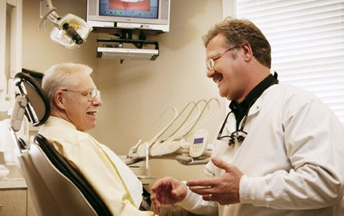 dentist with elderly patient