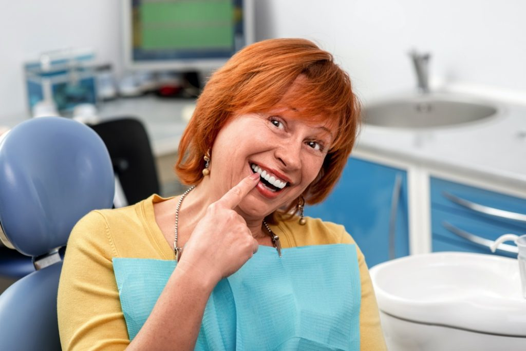 Woman with dental implants from Marietta