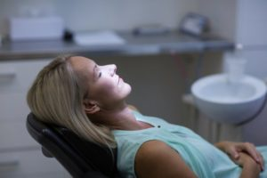 Woman safely relaxing while visiting her Marietta sedation dentist