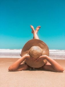 Woman on vacation using tips to prevent dental emergencies.